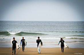 Men in black going to surf